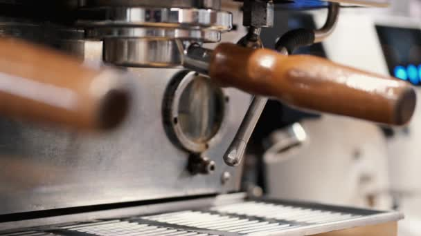 The barista is preparing steamy milk for latte in a coffee machine