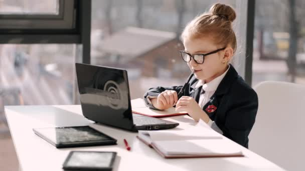 Primary school girl is on distance learning at home