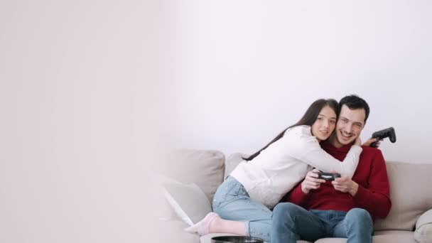 A pretty girl and a boy are playing video games in the living room