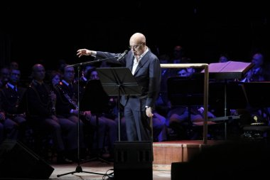 The actor Luca Zingaretti performs on stage