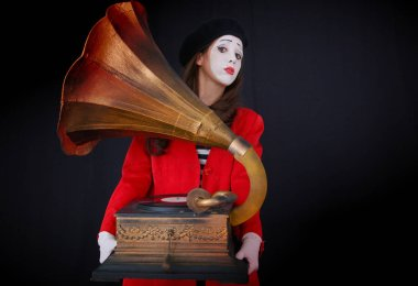 Girl MIME holding in his hand an  gramophone