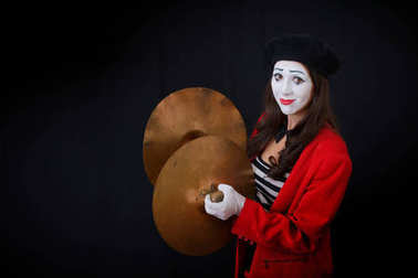 the girl is MIME is a slap in  timpani