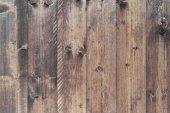 Priorità bassa strutturata di grigio-marrone in legno grezzo