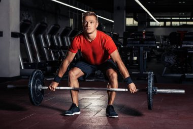 Young man at a crossfit gym