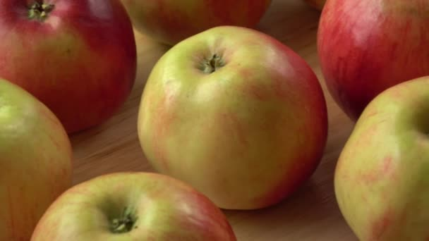 Red apples on wooden background,natural food.