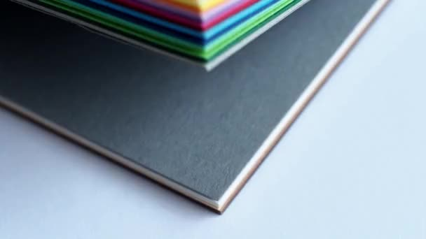 Colour swatches book. Rainbow sample colors catalogue. Turns over the colored paper.