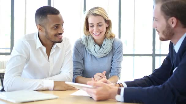 Mutiracial couple with a real estate agent