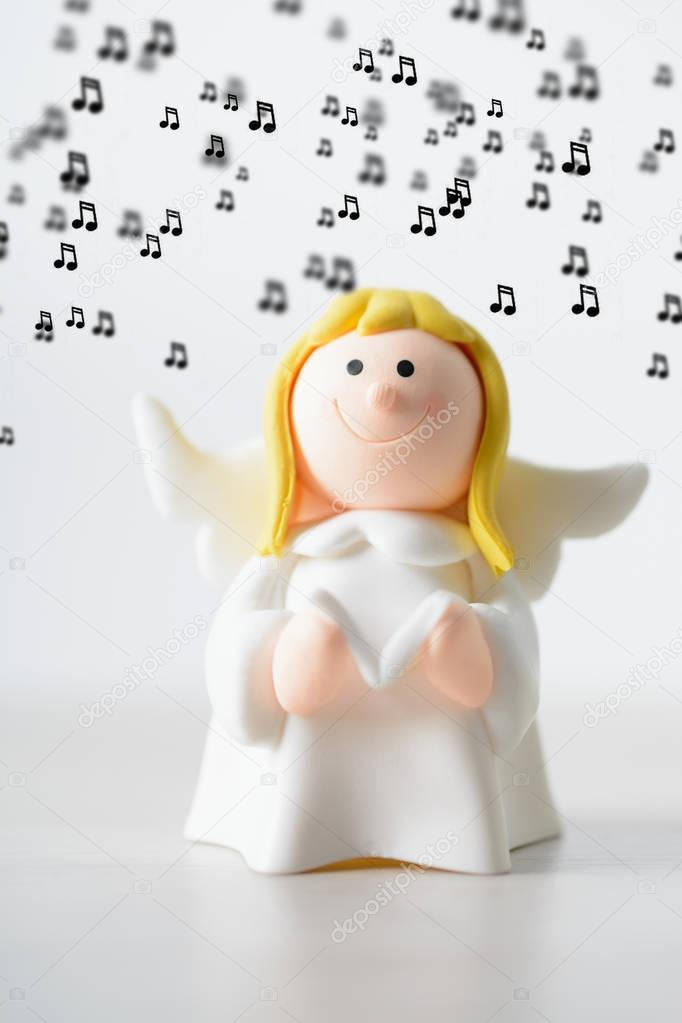 Toy Christmas angel with a book singing background music — Stock
