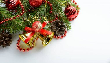 Christmas decoration bell, pine cones and branch