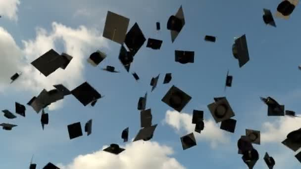 Graduation hats in the air on the blue sky background, university graduation