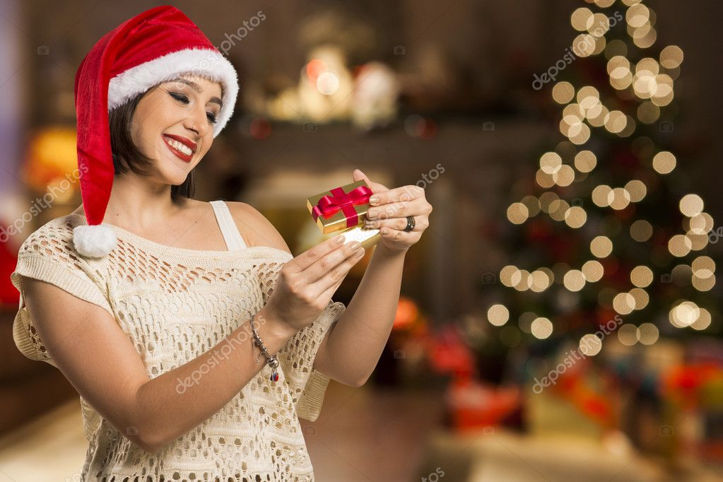 Christmas gift woman opening gift surprised and happy young b christmas gift woman opening gift surprised and happy young b negle Gallery