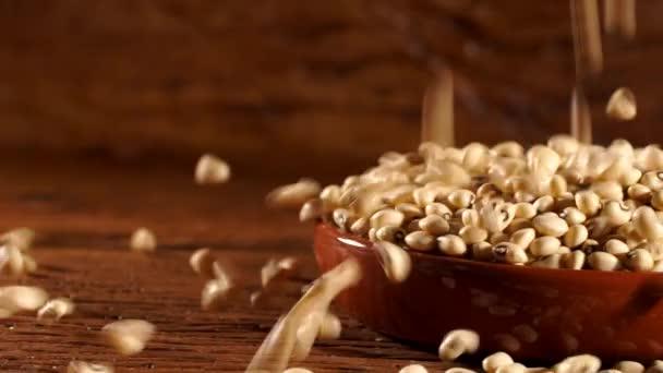beans falling in bowl