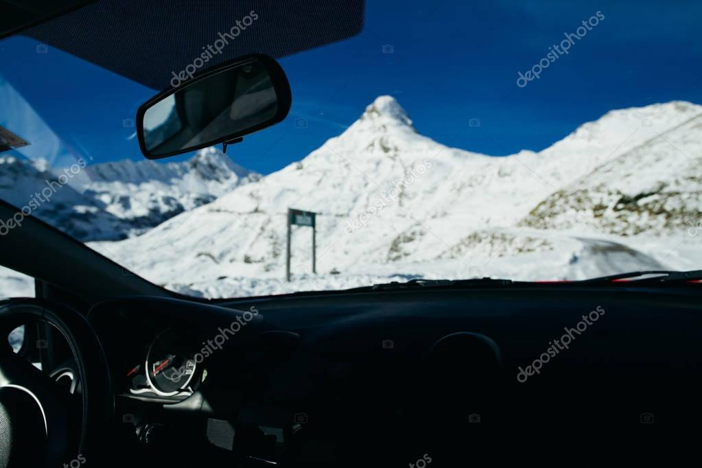 travelling by car in winter mountains