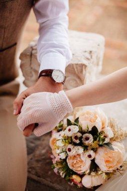 newlyweds holding wedding bouquet