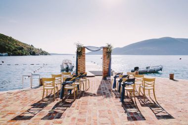 wedding arch decoration with sea view. Arch made of bricks.