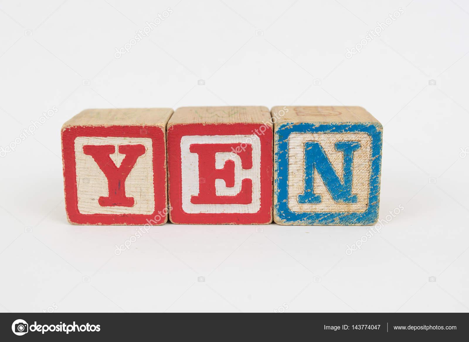 The Word Yen In Wooden Childrens Blocks Stock Photo Jhlemmer
