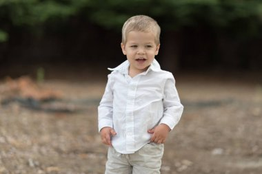 Cute Happy Toddler in White Shirt