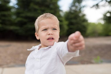 Young Toddler Portrait Outside Pointing