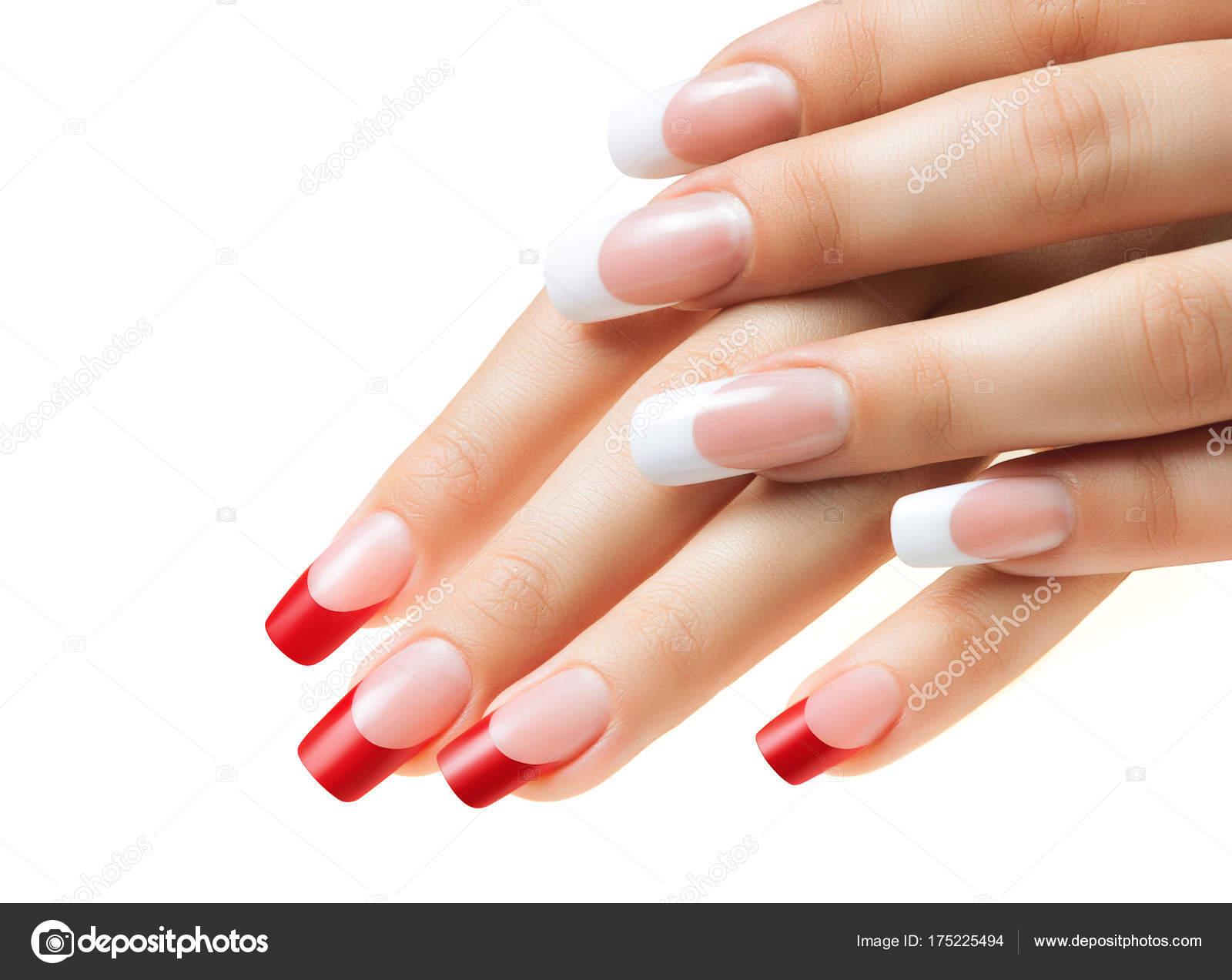 Händen der Mädchen. Weibliche Maniküre. Rote und weiße Nägel ...