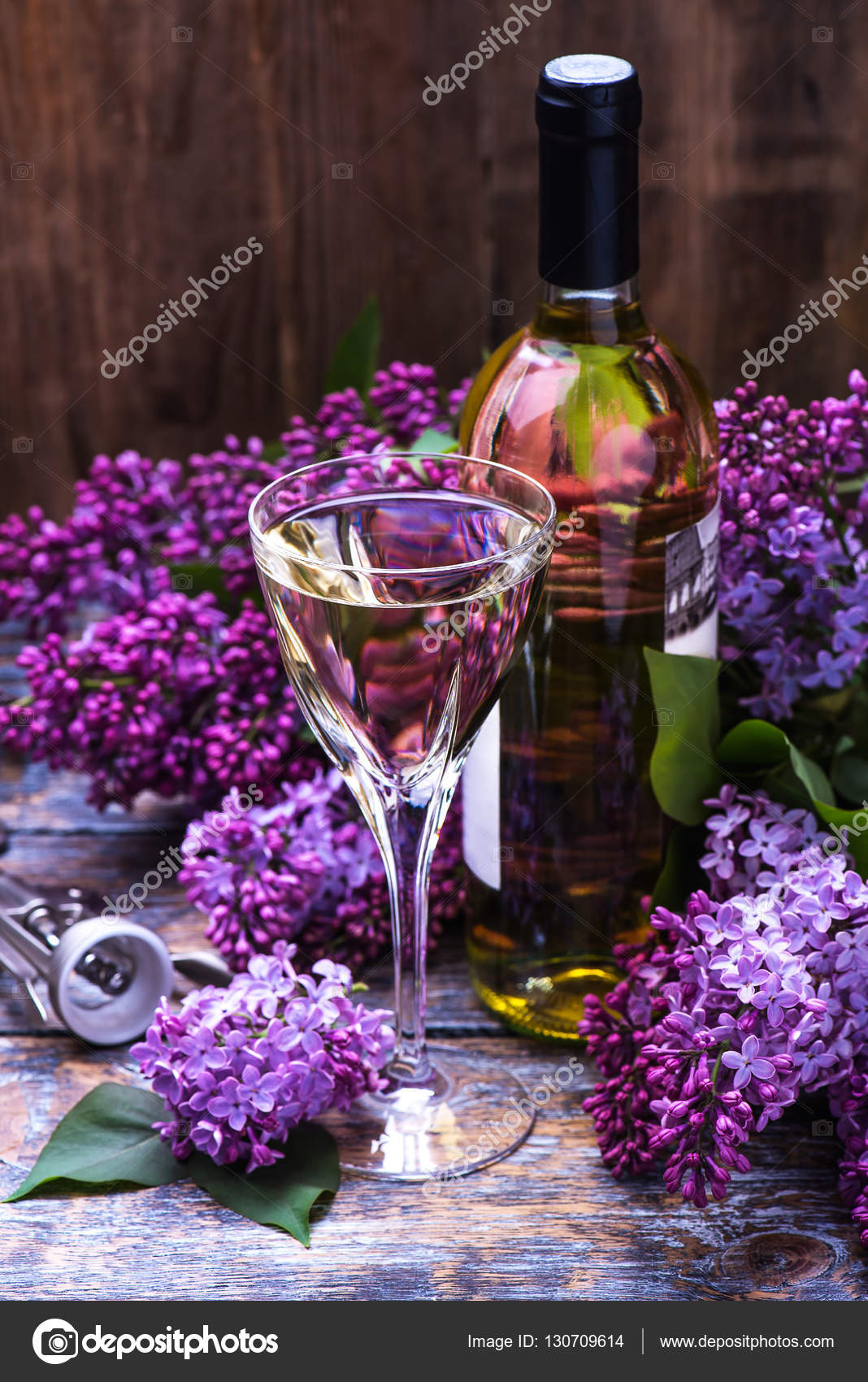 White wine in a glass and a bottle with lilac flowers on a wooden white wine in a glass and a bottle with lilac flowers on a wooden board mightylinksfo