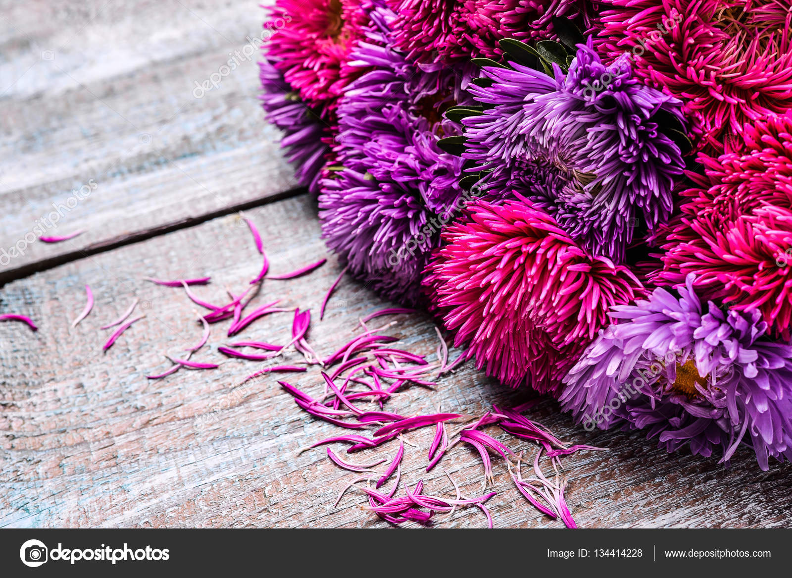 Aster flowers bouquet purple red pink white on a wooden background aster flowers bouquet purple red pink white on a wooden background selective focus photo by nataliiagl izmirmasajfo