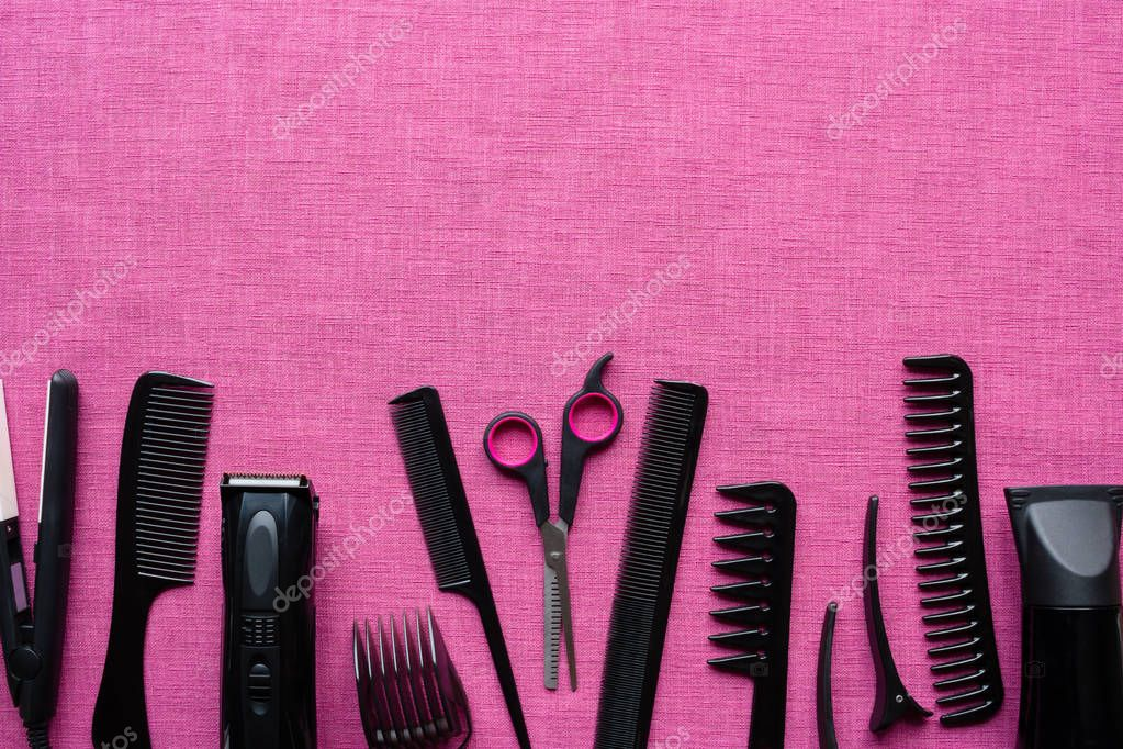 Hairdressing tools on pink background and space for text ...