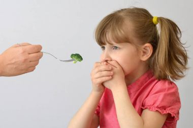 child, kid, does not like broccoli.