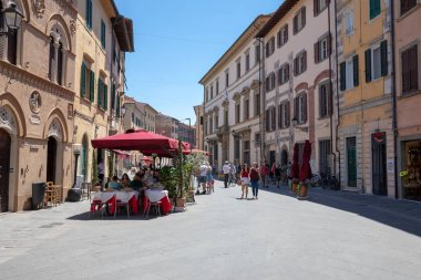 Walking on Borgo Stretto street in Pisa city with historic build