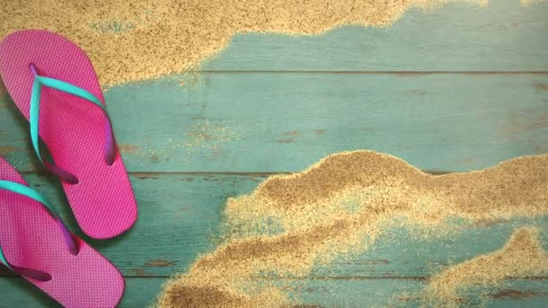 Closeup sandy beach with sandal on wood, summer background