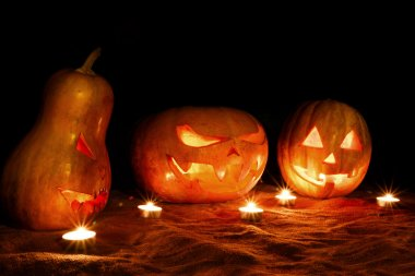 halloween three pumpkins jack lamp in the darkness among the can