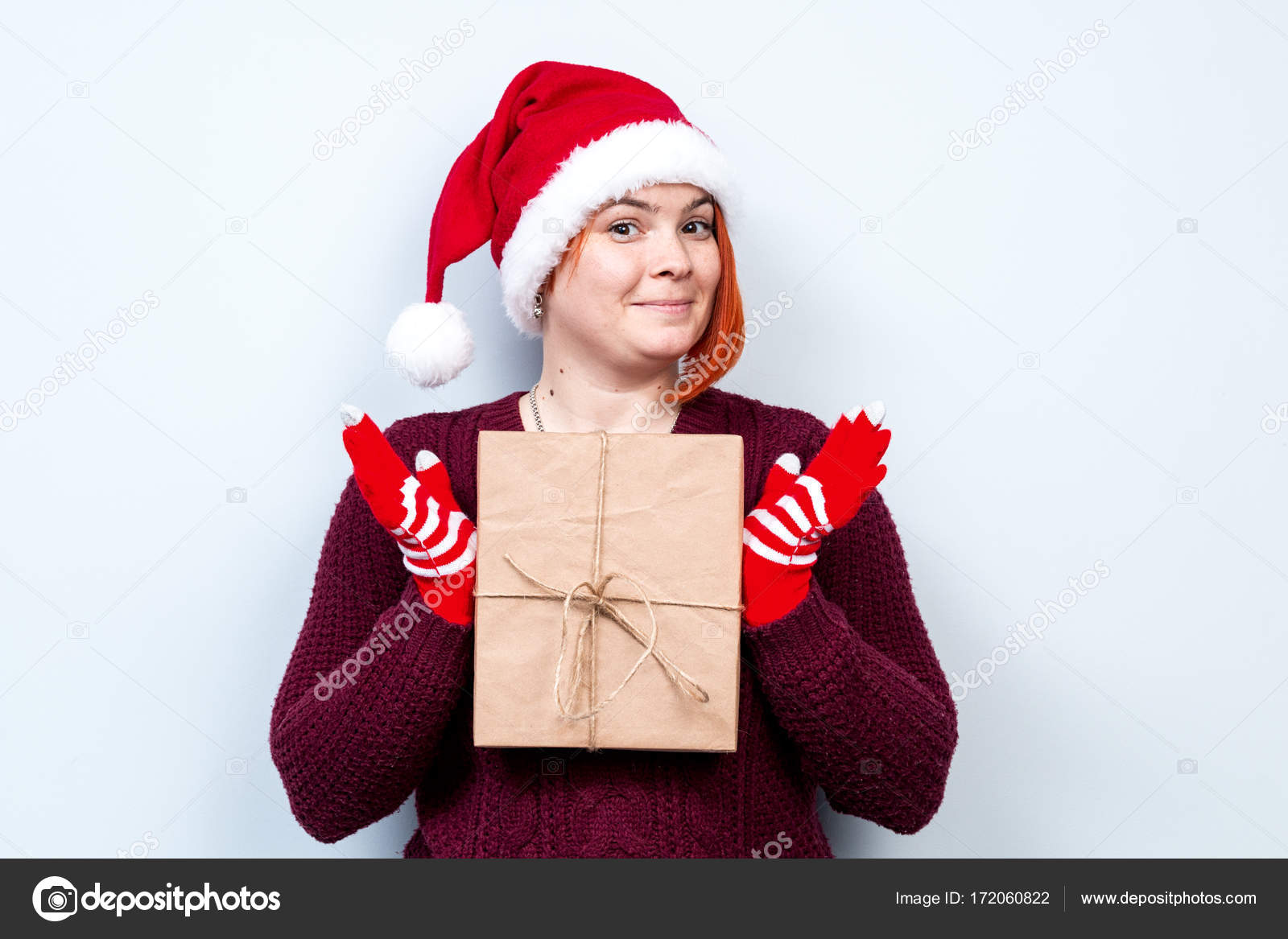 Spirit Of Christmas And New Year Concept Of A Holiday And Days Off A Cool Girl In A Santa Claus Hat Very Beautiful Portrait Of A Woman With A Gift