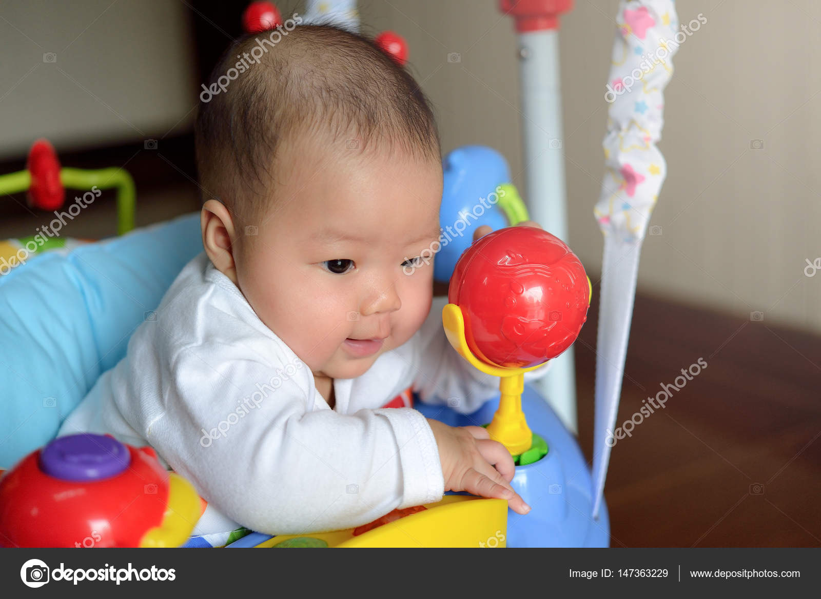 f16d0dc5d asian girl baby playing jumper toy — Stock Photo © khumthongonline ...
