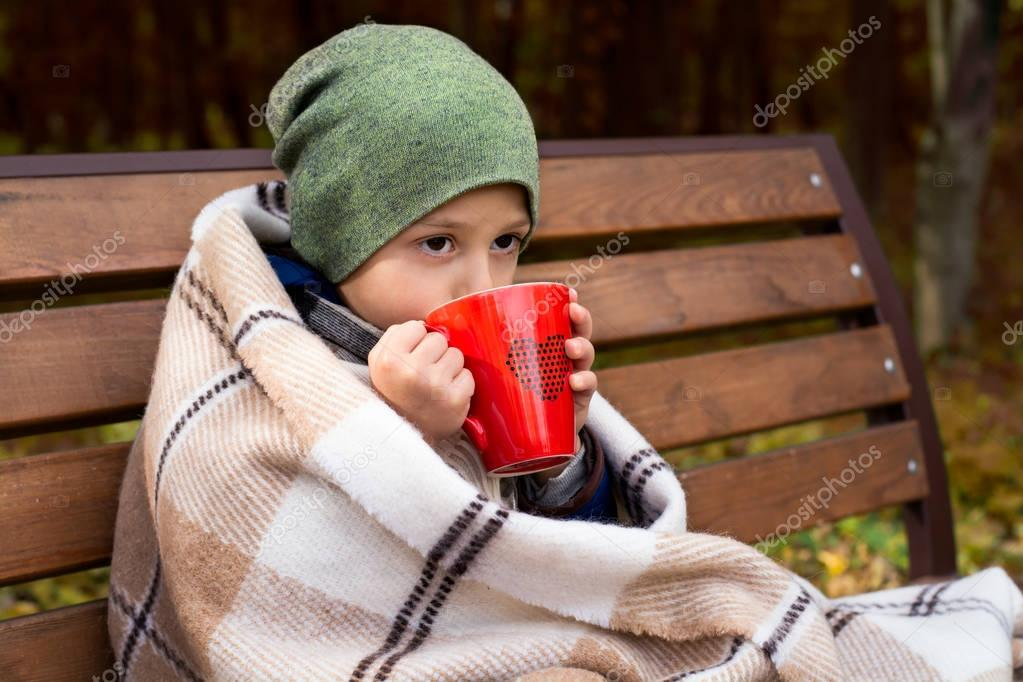 boy with hot mug of tea
