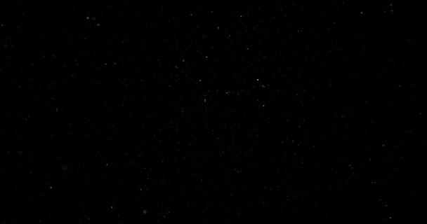 Repülő porszemcsék a fekete háttér