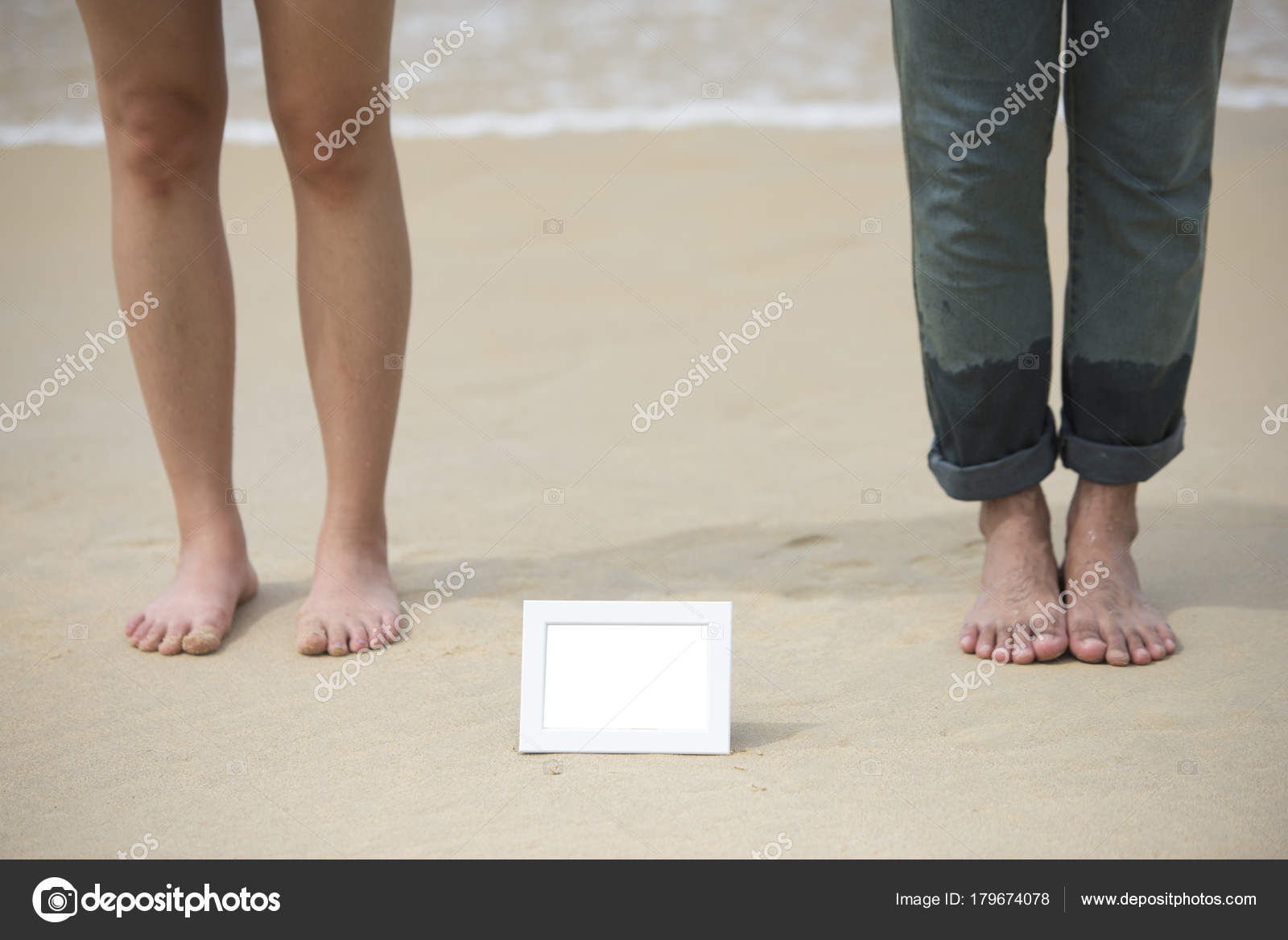 blurred two feet of asian couple with white empty picture frame