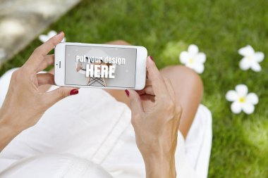 woman viewing pictures on cell phone