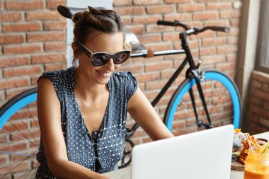 woman blogger in front of open laptop