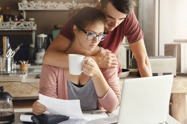 female doing paperwork with her husband