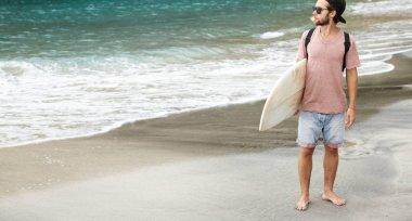 tourist wearing sunglasses, holding body board