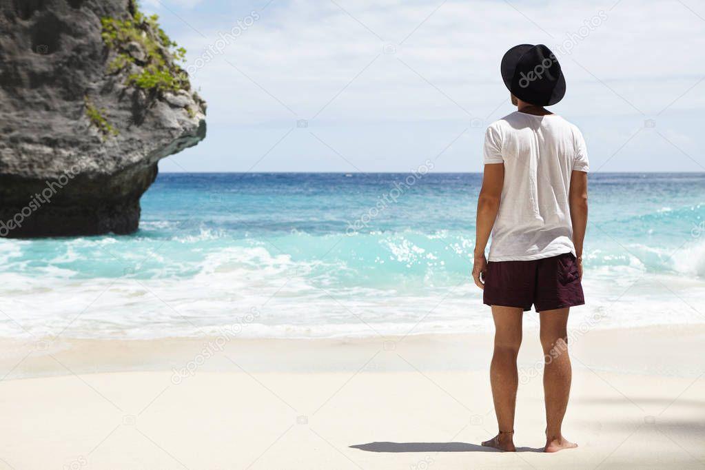 adventurer standing on sandy shore