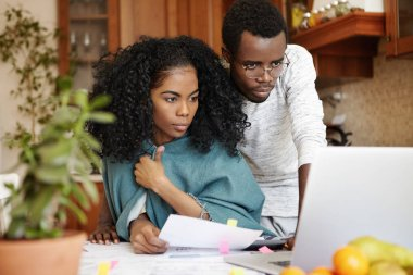 husband and wife using laptop