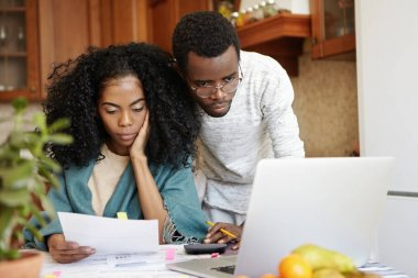 family paying utility bills