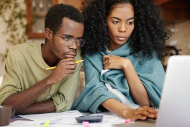 African wife and husband with many debts