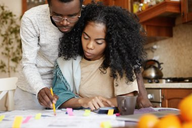 African couple having many debts
