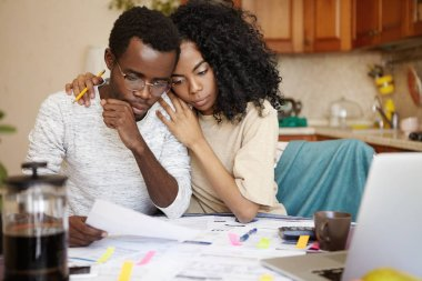 African couple undergoing financial difficulties