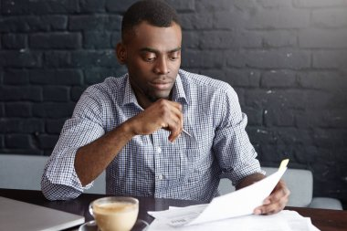 entrepreneur studying documents