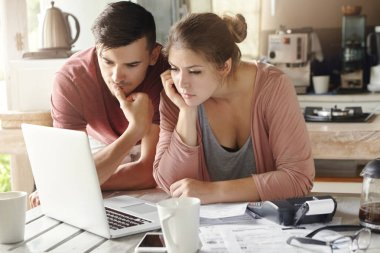 man and woman in front of open laptop