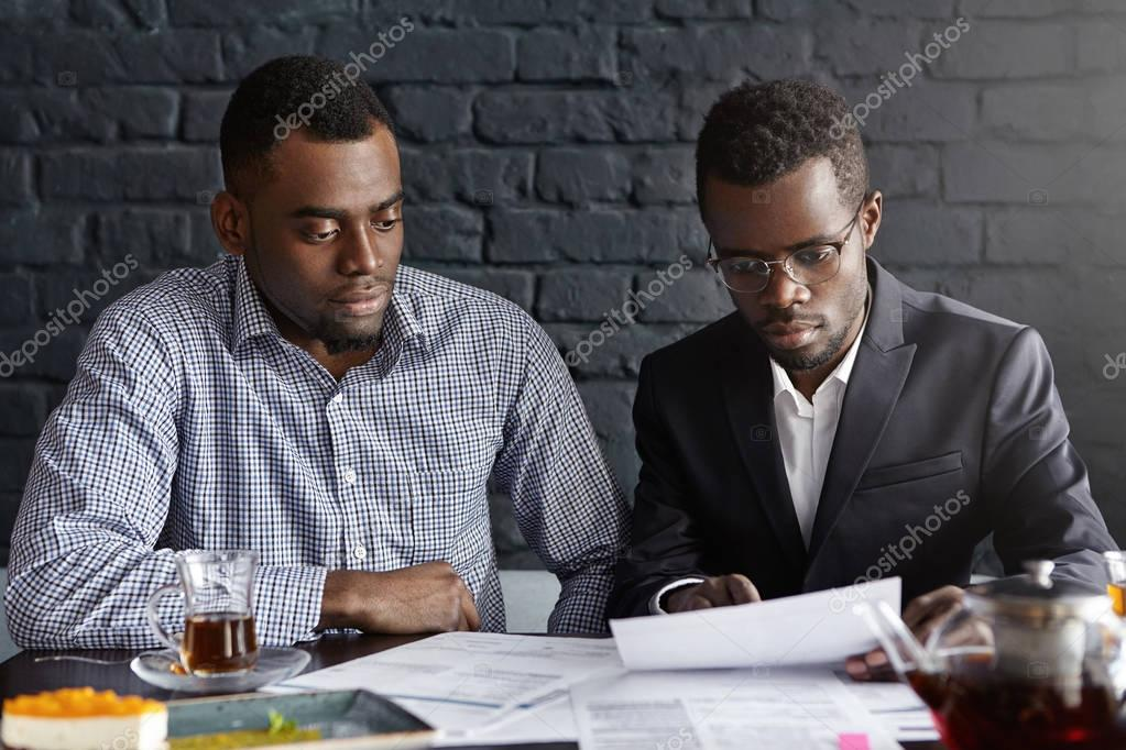 African-American executives reviewing financial report