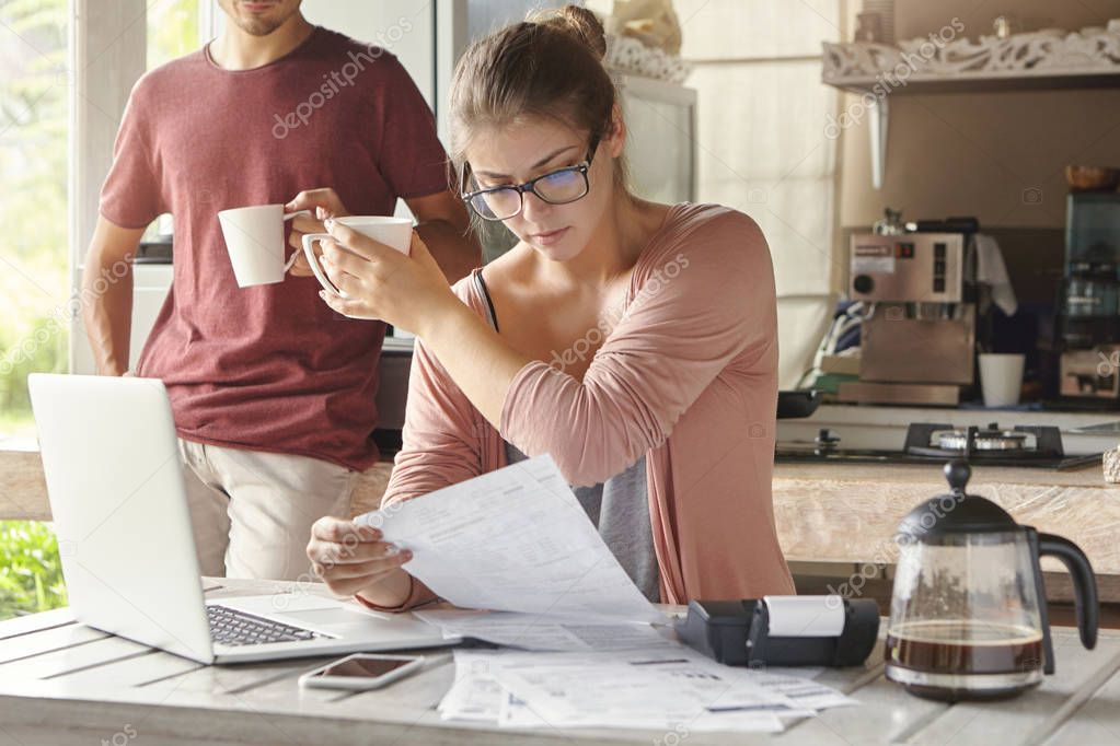family calculating bills