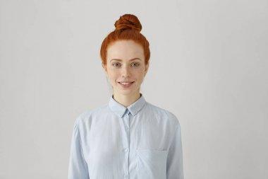 redhead female with hair bun